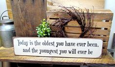 """This wooden Inspirational sign is made from local NH pine, and measures Approx 5.5""""W x 25""""L. It reads """"Today Is The Oldest You Have Ever Been And The Youngest You Will Ever Be"""" The front is painted Cr"""