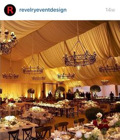 Image from Mindy Weiss Tented Wedding from @yitzhakdalalphotography. The tent was draped with soft sheer fabric and custom chandeliers added interest to installation. The perimeter drape was uplit and draped in the same fabric as ceiling. Guests were seating on Napa X Back chairs at Rectangle round tables.