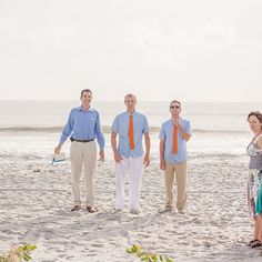 Chad was all smiles as he waited for his bride to walk down the aisle. He and his groomsman wore light blue button ups and bright orange ties. In keeping with the beach theme, no shoes were needed at this ceremony!  Photo Credit- Chloe Austin Photography
