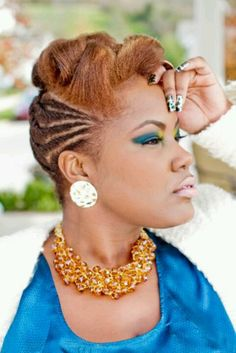 Lovely hairstyle, cornrow and swirled updo.