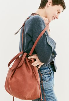 madewell drawstring transport tote worn with the high-rise slim boyjean + button-sleeve sweater.
