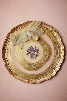 """Firenze Tray in Décor: Handpainted by Italian master craftsman trained in Florentine decorative techniques, the intricate florals and filigrees make for a breathtaking backdrop for any type of display. An exclusive BHLDN collaboration with Sezzatini.  For decorative use only: not food safe  17"""" diameter  Poplar wood  Gently hand wash  Handmade in Italy"""