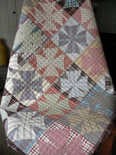 Sew Kind Of Wonderful:  Spinning Wheels Love the quilting, love the fabrics, love everything about it!