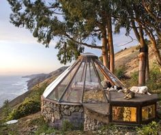 BEACH HOUSE: Built by Micky Muennig in 1976, this tiny house features a round floor plan with a glass dome roof. Location, Big Sur, California