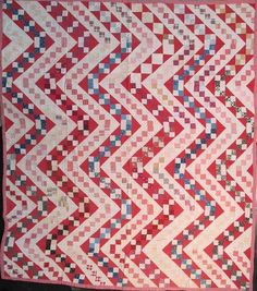 Streak of Lightning Antique Quilt,  mostly red and white early 20th century prints.  Perkioman Valley, PA.  Seen at Laura Fisher Quilts