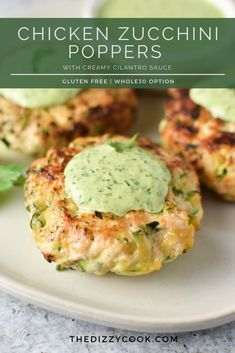 Chicken Zucchini Poppers with Creamy Cilantro Sauce - - These garlic and zucchini chicken patties are easy to make, healthy, and delicious. Topped with a little creamy cilantro sauce, they're the perfect gluten free weeknight meal. Diet Recipes, Cooking Recipes, Healthy Recipes, Recipies, Clean Eating, Healthy Eating, Chicken Zucchini Poppers, Sauce Crémeuse, Zuchinni Recipes