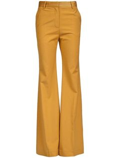 Cleofe high waist pants in mustard from Malene Birger. These wide leg trousers feature belt loops, zip front closure, single pleat in the front and four pocket design.