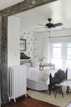 White and black vintage farmhouse bedroom with stunning black bed