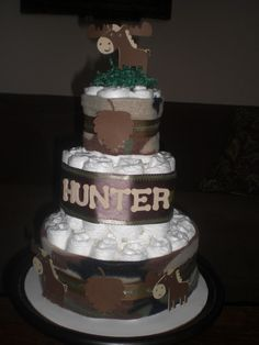 Hunting Camoflage Army Diaper Cake Baby Shower Centerpiece or gift other ribbon colors too. $40.00, via Etsy.