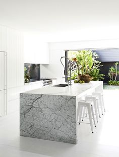 "A waterside family home on Sydney's Northern Beaches:The kitchen opens to a lush courtyard garden.   Carrara marble on **benchtop** from [BK Stone](http://www.bkstone.com.au/|target=""_blank""). [Gessi](http://www.gessi.com/