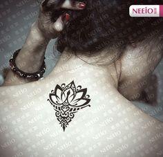 Small Buddhist Lotus Tattoo On Upper Back