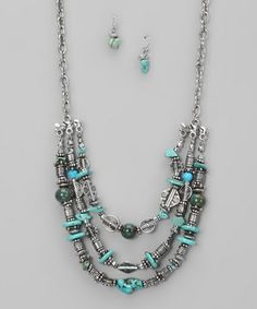 This pretty beaded necklace and earring set is sure to dazzle the masses. Silver and turquoise combine, forming a most marvelous set.