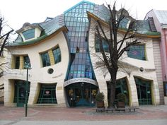 "POLAND – Krzywy Domek is part of the Rezydent shopping centre in Sopot, Pomerelia. The name of the building means ""crooked little house"" and is located at Bohaterów Monte Cassino 53 @ Generała Józefa Bema. https://www.google.ca/maps/place/Krzywy+Domek/@54.4441379,18.5658382,18z/data=!4m5!3m4!1s0x46fd0a80ca6d63b1:0xa475a4feb561f099!8m2!3d54.4442013!4d18.5666948"