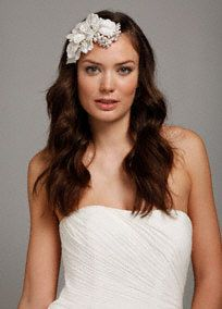 "Wear this stunning crystal and pearl flower headpiece on your wedding day and feel transformed!  With it's large felt petals striped with silver thread and adorned with pearl and crystal sprays, this piece is a statement that says, ""It's my special day!""  Flower headpiece comes with a salon clip attached to easily secure into your hair, keeping your look flawless.  Available in: Ivory.  Imported."