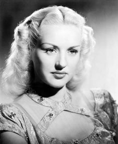 Betty Grable....In 1943, she was the number one box office draw in the world and, in 1947, she was the highest-paid entertainer in the United States. Two of her biggest film successes were the musical Mother Wore Tights (1947) and the comedy How to Marry a Millionaire (1953), one of her last films. Grable retired from screen acting in 1955 after she withdrew from her Fox contract, although she continued to perform on the stage and on television.