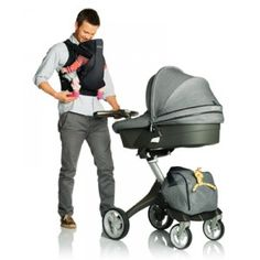 Stokke Xplory Stroller with dad and baby and carrier in Johannesburg