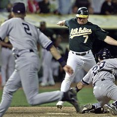 Jeremy Giambi (center) of the A's is tagged out at home by Yankees catcher Jorge Posada during Game 3 of the American League Division Series, in Oakland on Oct. 13, 2001. Giambi tried to score from first on a double from Terrence Long in the seventh inning, but Derek Jeter (2) raced across the infield to flip an errant relay throw to Posada. The Yanks went on to win the game and two more, which propelled them to the ALCS and World Series