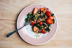 Farro, Kale, And Strawberry Salad With Bacon and Chili-Dusted Pepitas