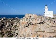 Sold! Stock photo available for sale at Shutterstock: White lighthouse at Capo Testa, Sardinia, Italy. - stock photo