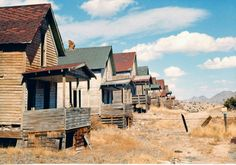 Row of abandoned houses - Madrid, New Mexico.  Old Homes  pinterest.com/multicityworld/old-homes/  multicityworldtravel.com Hotel And Flight Deals.