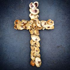 This is just beautiful.  Oyster Shell Cross Wall Decor by RusticMagnoliaDesign on Etsy