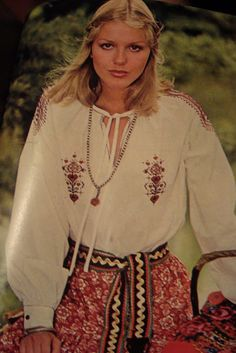 Peasant-style shirt worn with chain and pendant, from the fashion pages of Seventeen magazine, Oct. 1977.