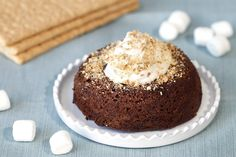 Hungry Girl's Healthy S'mores Cake in a Mug Recipe  Entire recipe: 202 calories, 4g total fat (2g sat fat), 243mg sodium, 33.5g carbs, 5.5g fiber, 8.5g sugars, 10.5g protein  SmartPoints® value 5*  This may be our best cake mug yet. The melty marshmallows give this sweet treat an incredible texture!  Prep: 5 minutes Cook: 5 minutes or less Cool: 10 minutes  Ingredients: 2 tbsp. whole-wheat flour 2 tbsp. unsweetened cocoa powder 3 packets no-calorie sweetener 1/4 tsp.