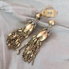 NWT J. Crew Flower Bud Tassel Earrings Gorgeous gold earrings from J.Crew with fun tassel details! I also think these would be a great DIY project - turn them into necklaces! That was actually why I bought these but I have never gotten around to executing my DIY plans. New with tags and never worn. NO TRADESPRICED TO SELL J. Crew Jewelry Earrings