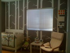 """This is by far my most favorite """"tree"""" wall I've ever seen. Resembles stripes, not too cheezy, but still fun for a nursery!  Not in love with having a nursery """"theme"""" so nix the owls, though."""