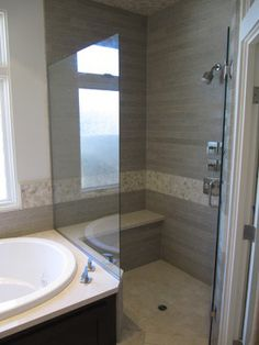 Bathroom tile & shower bench - like the lowered shower accent stripe - different and cleaner look