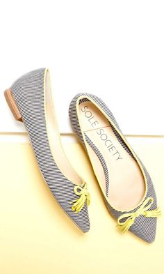 Luxurious striped ballet flat with a pointed toe, yellow contrast piping and charming tassel bow at front toe.
