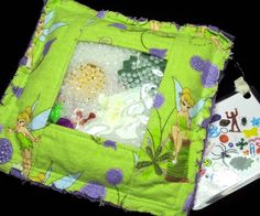 I am getting these for Easter Basket Gifts!  How cool!   Tinkerbell  I Spy Bag  Tinker Bell Rag eye by KNHDesigns, $16.95