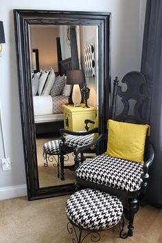 LOVE. black mirror leaning on the wall and houndstooth chair with yellow accent...( I'm thinkking red accents would be better!)