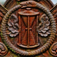 Oubouros and a winged hourglass at one of the Old Town Cemeteries, Stirling, Stirlingshire, Scotland, UK