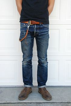 nice pair of jeans. cool desert boots. cool belt.