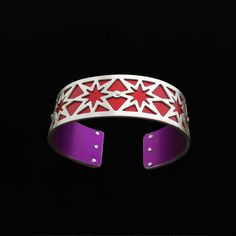 Handmade from sterling silver and anodized aluminum. #ilovegogojewelry #star #cuff
