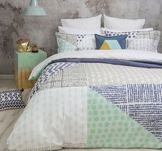 Rae BAMBURY  Printed in an array of unique geometric patterns comes Rae, a wonderful collaboration of pattern and colour. The calming blue, green and grey tones are complimented with a simple yet stylish cross pattern reverse.  Features: Cotton sateen Printed Blue piping Cross pattern reverse - #quiltcovers