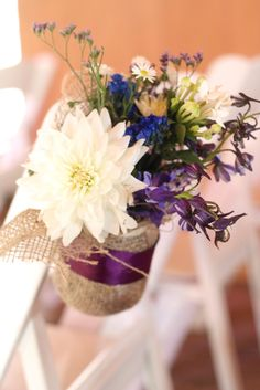 Simple aisle decor. Mason jars wrapped in burlap with a ribbon glued around. Use twine to tie to chairs. Fill with flowers or other decor.    The Parkland Project: The Wedding: Ceremony Details  Reception Party!
