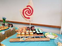 Loving the canoe full of cupcakes at this Moana birthday party!! See more party ideas and share yours at CatchMyParty.com #catchmyparty #moana #cupcakes