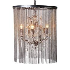 We love this crystal and chain ceiling light. Stunning strands of chain mail covering a delicate crystal chandelier £539.99  www.hanaleyinteriors.co.uk