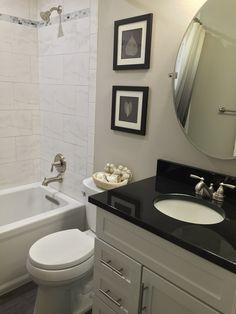 Traditional Bathroom Black Granite Countertop On White ... on Bathroom Ideas With Black Granite Countertops  id=85932