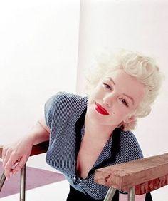 REFLECTIONS — Marilyn Monroe, 1955. Photograph taken by Milton...