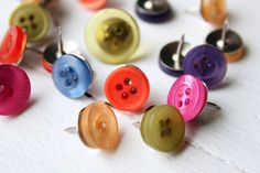 Button Push Pins by When It Rains - $4.00 »  Why use regular thumbtacks when you can add color with these fun button ones? They're the perfect complement to the fabric memo board.