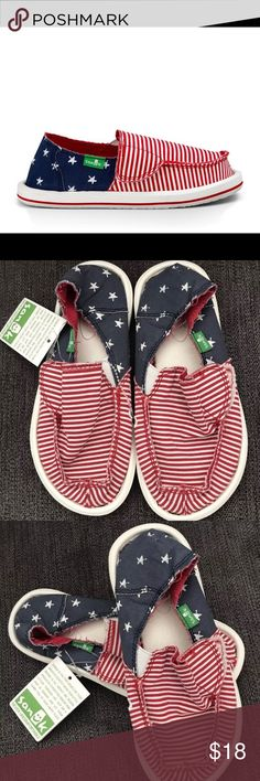 Kids Sanuk Flag Print Canvas upper with Contrast canvas lining Super soft, high rebound, molded EVA footbed with AEGIS antimicrobial treatment Sanuk logo tag on side Blue stripe on midsole Happy U rubber sponge outsole . With Velcro snap Sanuk Shoes