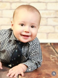 Amanda Abraham Photography specializing in newborn and child photography. Using fun props to enhance your photo experience in the Metro Detroit area! www.amandaabrahamphotography.com Baby boy 9 Month session in studio.