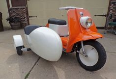 In its long history, Harley-Davidson has only created one scooter. As you might guess, it was not a commercial success. Harley offered to rare factory options that could be mounted on the side – either a utility box or an adorable sidecar. This restored Topper has one of the latter.