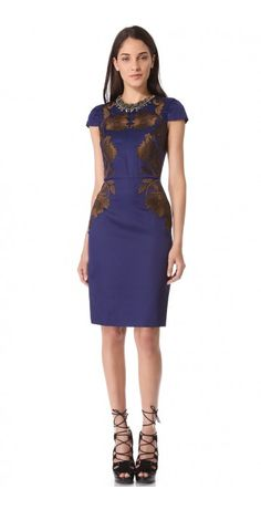 IRIS PENCIL DRESS $740.22 Embroidered blossoms contrast against dark charmeuse on a slim, elegant Temperley London dress. This polished piece is designed with flattering cap sleeves and a nipped waist. A short back slit finishes the skirt. Hidden back zip. Lined.