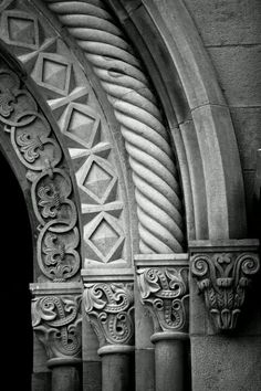 Romanesque style - is marked by great variation in decoration.  The carvings are very geometric and appear above the portal (archway) into a cathedral.  Note the columns are slender with a smallish capital.  The capital does have some carving at the top that is very detailed.