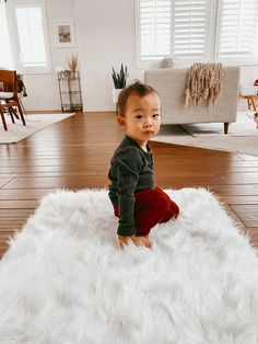 Add a touch of luxury to any room with our plush Polar White Shag Rug. Made with 100% faux fur, this high-pile rug features a gorgeous white color, as well as long, luxurious fibers that deliver a soft, cozy feel. Durable, stain-resistant, and machine washable, this stylish white shag rug holds up exceptionally well to foot traffic and hours of play. Actual colors may slightly vary based on room lighting conditions.