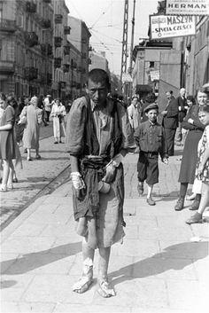 A young Jewish man, homeless and ill, is photographed in the Warsaw Ghetto. The largest of all the Jewish ghettos in Nazi-occupied Europe, it was established in the Polish capital between October and November 1940. Over 400,000 Jews from the city and...